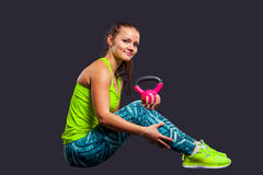Young woman smiling while using kettlebells Stock Photos