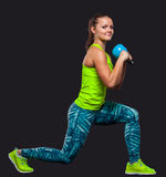 Young woman smiling while using kettlebells Royalty Free Stock Images
