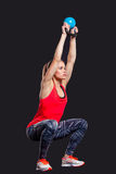 Young woman smiling while using kettlebells Royalty Free Stock Photos