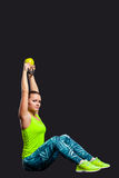 Young woman smiling while using kettlebells Royalty Free Stock Photo