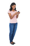 Young woman smiling and using mobile phone Stock Images