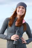 Young woman smiling with water bottle outdoors Royalty Free Stock Photos