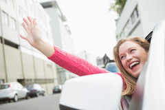 Young woman smiling and waving Royalty Free Stock Photo