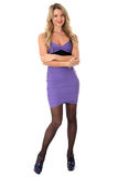 Young Woman Smiling Wearing Tight Purple Short Mini Dress With Arms Folded And High Heels Stock Photo