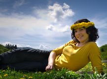 A young woman smiling wearing a yellow top Stock Images