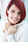 Young woman smiling with white sweater Stock Photo