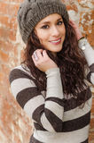 Young woman smiling with wool hat Stock Image