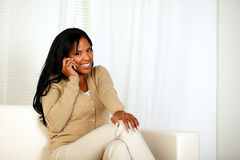 Young woman smiling at you while speaking on phone Stock Photography