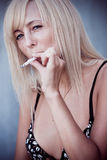 Young woman a-smoke royalty free stock photography