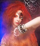 Young woman. Smoke and young ginger woman with artistic visage royalty free stock images