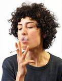 Young woman smokes Stock Photography