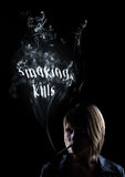 Young woman smokes smoking kills Royalty Free Stock Photos