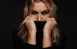 Young woman with smokey eye makeup Stock Photos
