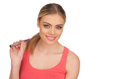 Young Woman Smokin Electic Cigarette Stock Photography