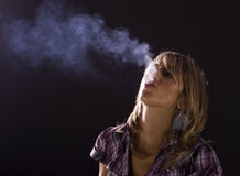 Young woman smoking Stock Photo