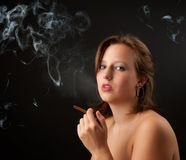 Young woman smoking Royalty Free Stock Images