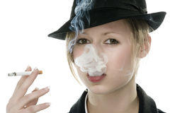 Young woman smoking Stock Images