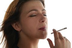 Young woman is smoking Stock Photos