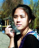 A Young woman smoking Cigar Stock Photo