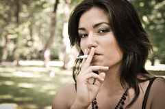 Young woman smoking cigarette Royalty Free Stock Photos