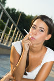 Young woman smoking a cigarette Stock Image