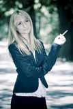 Young woman smoking cigarette Royalty Free Stock Photo