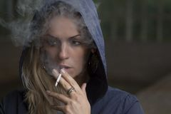 Young woman smoking a cigarette Royalty Free Stock Photography