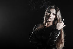Young woman smoking a cigarette Stock Photography