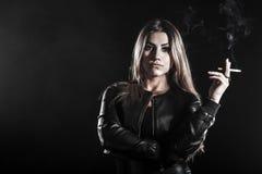 Young woman smoking a cigarette Stock Photo