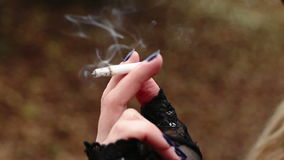 Young woman smoking a cigarette stock video