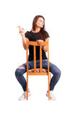 Young woman smoking cigarette on the chair Royalty Free Stock Photography