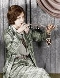 Young woman smoking a cigarette with a cigarette extension Royalty Free Stock Photo