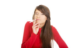 Young woman smoking cigarette. Royalty Free Stock Photo