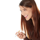 Young woman smoking electronic cigarette Stock Image