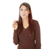 Young woman smoking electronic cigarette Stock Photography