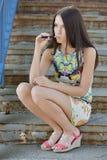 Young woman smoking electronic cigarette (e-cigarette) Stock Photos