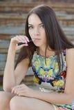 Young woman smoking electronic cigarette (e-cigarette) Stock Photo