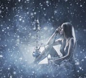 A young woman smoking a hookah on the snow Royalty Free Stock Photos