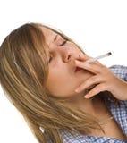 Young woman smoking Stock Photography