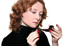 Young woman with smoking pipe Stock Photos