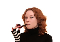 Young woman smoking a pipe Stock Photos