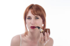 Young woman smoking a pipe Stock Images