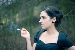 Young woman smoking Stock Photos