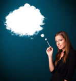 Young woman smoking unhealthy cigarette with dense smoke Royalty Free Stock Photography