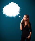 Young woman smoking unhealthy cigarette with dense smoke Stock Photography