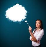 Young woman smoking unhealthy cigarette with dense smoke Stock Photo