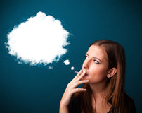 Young woman smoking unhealthy cigarette with dense smoke Royalty Free Stock Image