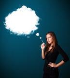 Young woman smoking unhealthy cigarette with dense smoke Royalty Free Stock Photo