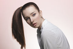 Young woman with smooth ponytail Royalty Free Stock Photo
