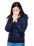 Young woman sneeze. Isolated on white background Stock Image